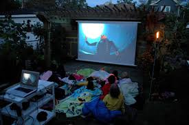 bring the movies to your backyard space living outdoors