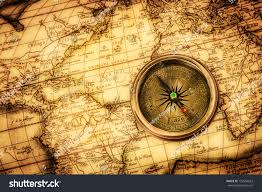 Ancient World Map by Vintage Still Life Vintage Compass Lies Stock Photo 132954623