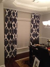 navy blue ikat curtains and sherwin williams repose gray paint in
