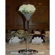 small glass fishbowl wedding table centerpiece with silk cream