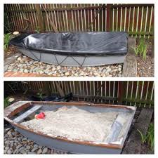simple but awesome sandpit idea old dingy or boat backyard
