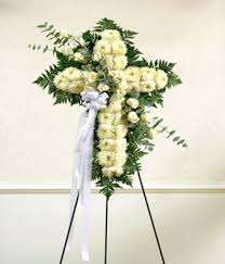 white floral standing cross with white roses at from you flowers