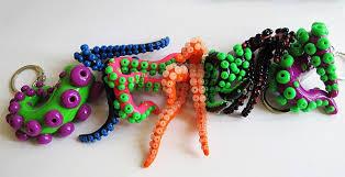 acrylic octopus ring holder images Octopus tentacle earrings jpg