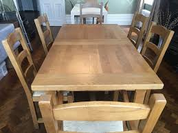 bergerac large oak extending table with 6 chairs and 2 door side