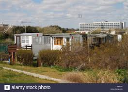 old railway carriages made into homes by the beach at bognor regis