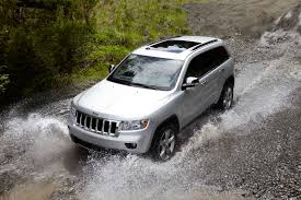 raised jeep grand cherokee first drive 2014 jeep grand cherokee rideapart