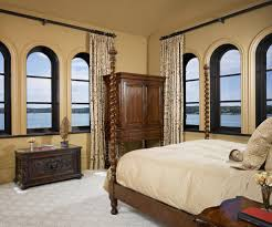 arch window curtains bedroom mediterranean with arched window bed