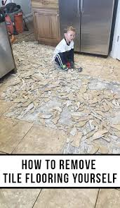 how to cut ceramic tile around kitchen cabinets how to remove tile flooring yourself with tips and tricks