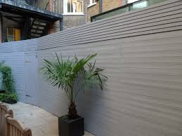 creative idea outdoor design with high grey modern fence green