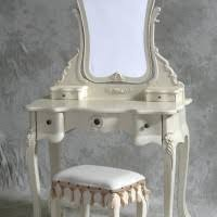 dressing table made of mirror having several drawers and tapered