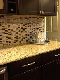pictures of kitchen backsplashes with granite countertops glass tile backsplash venetian gold granite countertop chocolate