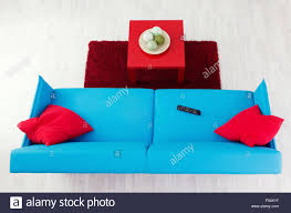 Red Pillows For Sofa by Blue Sofa With Red Pillows And Red Coffee Table Top View Stock
