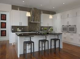 kitchens with stainless steel backsplash kitchen contemporary kitchen with white modern cabinet and