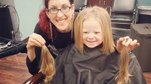three year old donates hair to locks of love after seeing