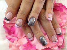 charcoal grey glitter and pink polish tips over acrylic nails