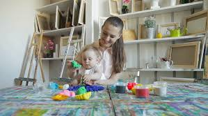 Decorate Easter Eggs Video by Mother And Son Decorating Easter Eggs On Table Indoor Stock