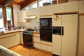 best paint for laminate cabinets before and after pictures of painted laminate kitchen cabinets www