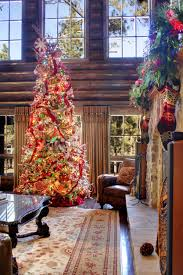 holiday decor rustic family room with stone fireplace and french