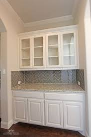 backsplash for small kitchen grey glass subway tile backsplash and white cabinet for small