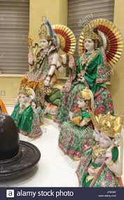 hindu l statues of hindu deities shiva and parvati rear l r and their