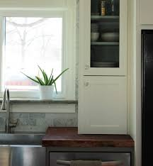 modern look of glass doors kitchen cabinets home design and