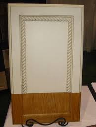 Flat Kitchen Cabinet Doors Makeover - inexpensively update old flat front cabinets by adding trim paint