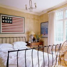 home decorating rules you can break cottage bedroom with iron bed and flag wall hanging
