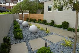 modern front landscaping planted with trees and ornamental plants