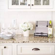 antique white kitchen cabinets with subway tile backsplash how to work with dated granite in your kitchen