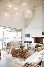 beach house design high ceiling with globe pendant lightins and