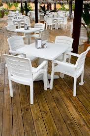 many white plastic chairs and tables stock photo image of
