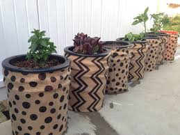 self watering garden through simple pots imgur