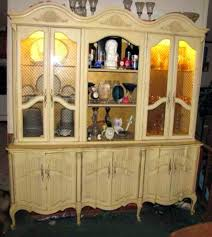 repurpose china cabinet in bedroom repurposing armoire doors as decorative wall shutters