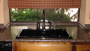 Laminated Countertops - traditional kitchen with laminate granite look countertops oil