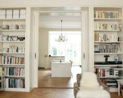 the den at dining in pocket doors surrounded by built ins perhaps for the den as