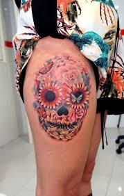 skull thigh tattoo by astin tattoo