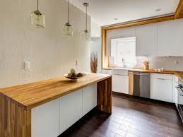 white kitchen cabinets with butcher block countertops butcher block countertop pros and cons casual and ecological