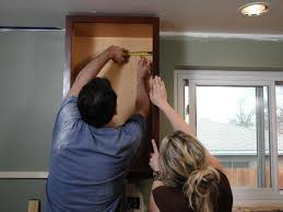 how to install cabinets with uneven ceiling kitchen catch up how to install cabinets how tos diy