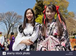 National Cherry Blossom Festival by Japanese Girls Enjoying National Cherry Blossom Festival Parade