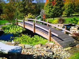 yard bridge backyard garden bridges landscapingandgardeningguide