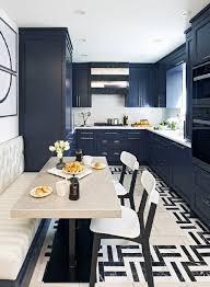 dark blue cabinets white solid countertop beige kitchen banquette