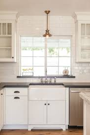 kitchen sink backsplash farmhouse sink with overhead pendant light by rafterhouse