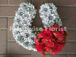 horseshoe wreath horseshoe wreath made in flowers for funerals comes in two sizes
