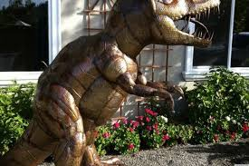 dug the t rex lawn dinosaur brings to a neighborhood in