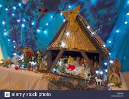 a domestic christmas crib nativity scene with multiple characters