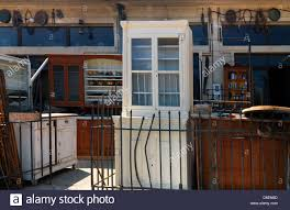 samos greece antique shop with furniture and ornaments stock photo