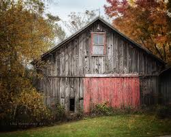 Red Barn Doors by Ok Barn With Wagon Wheels Jpg Tikspor