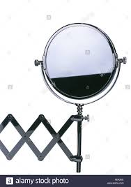 bathroom mirror on concertina wall stand stock photo royalty free