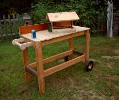 potting bench and bird feeder all reclaimed wood by