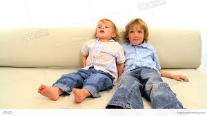 Two Little Boys Lying On The Sofa On White Background Stock Video - Lying sofa 2